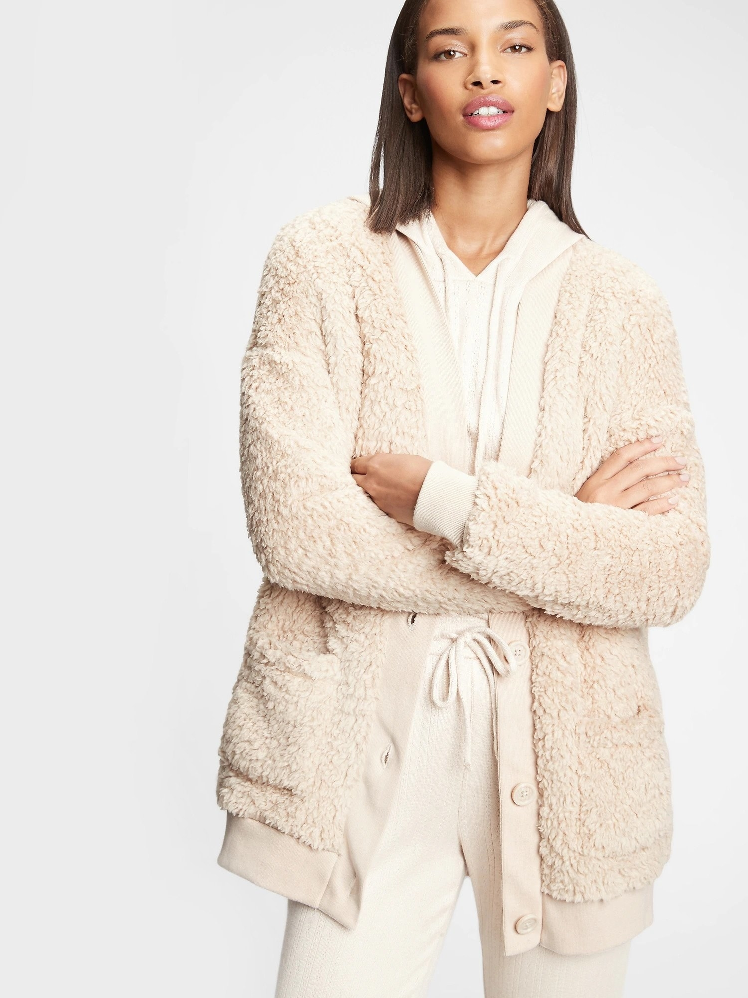 Model wearing sherpa cardigan