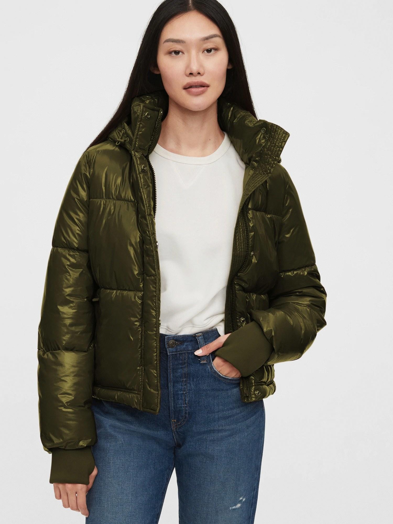 Model wearing green puffer jacket