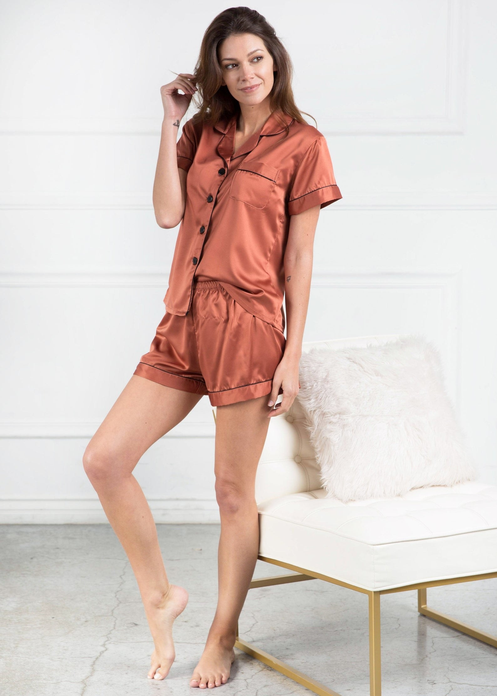 a model wears the short pajamas in copper