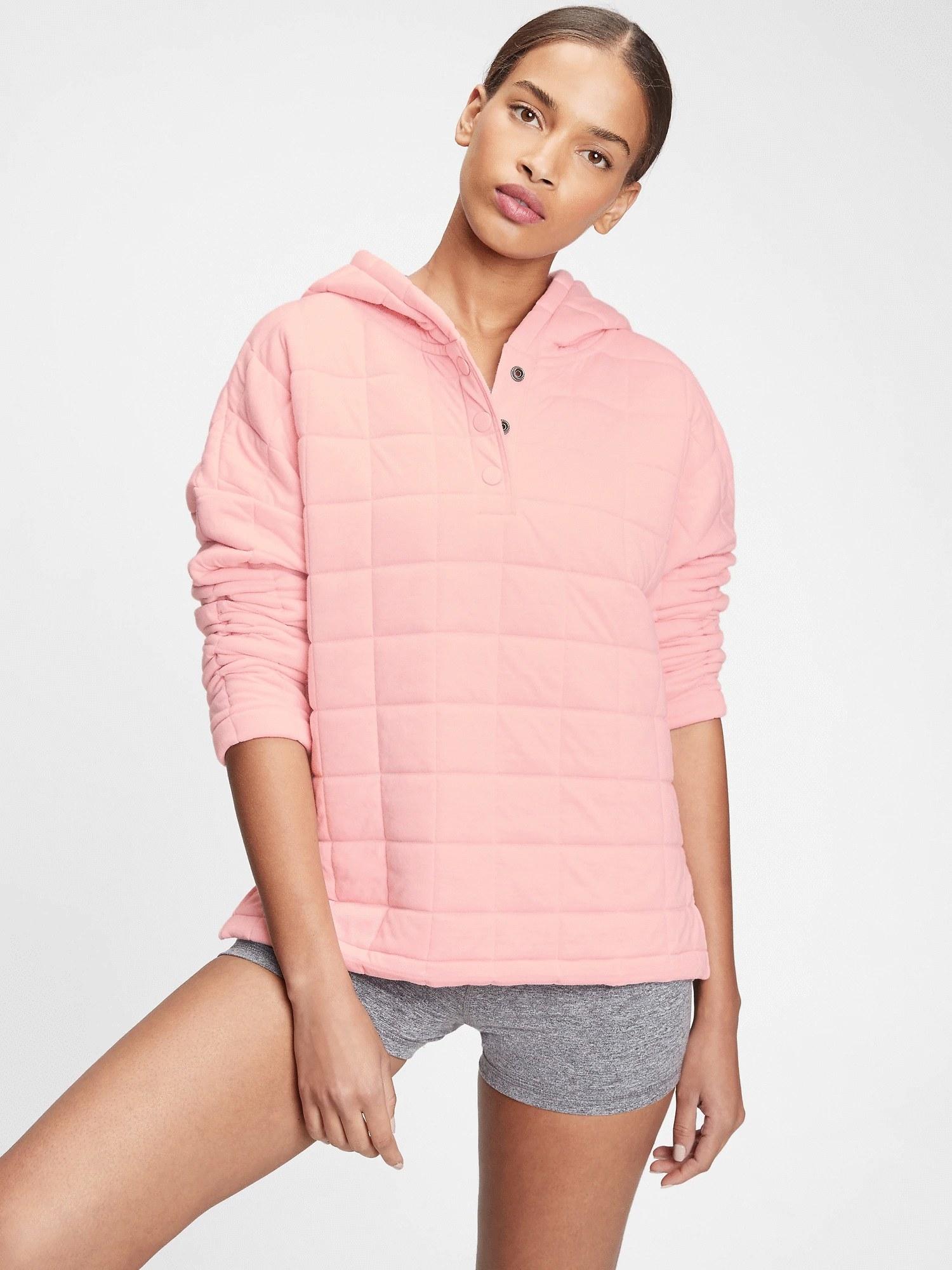 Model wearing pink hoodie