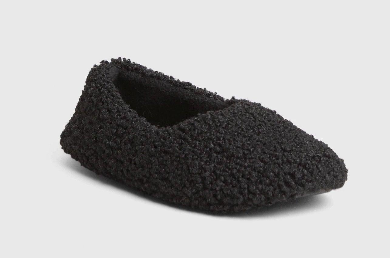 Black slipper on white background