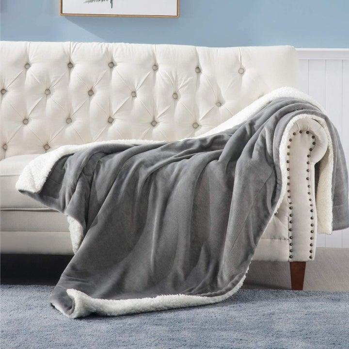 a plush gray throw blanket