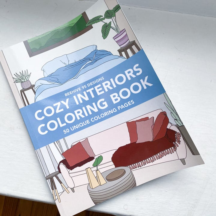 a reviewer's photo of a cozy interior's coloring book