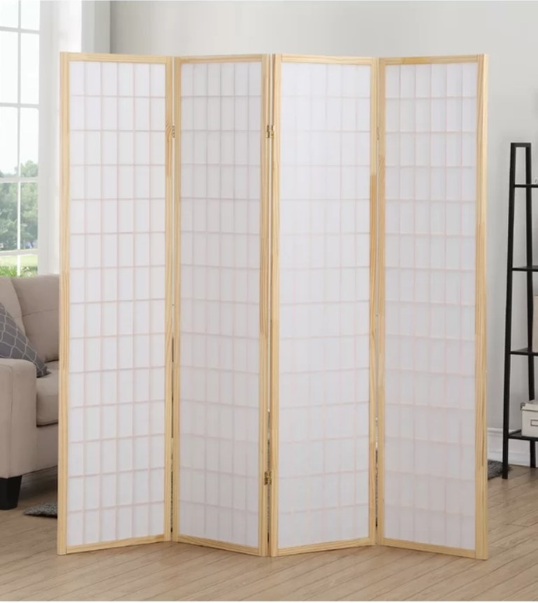Light wooden room divider with white rice paper panels