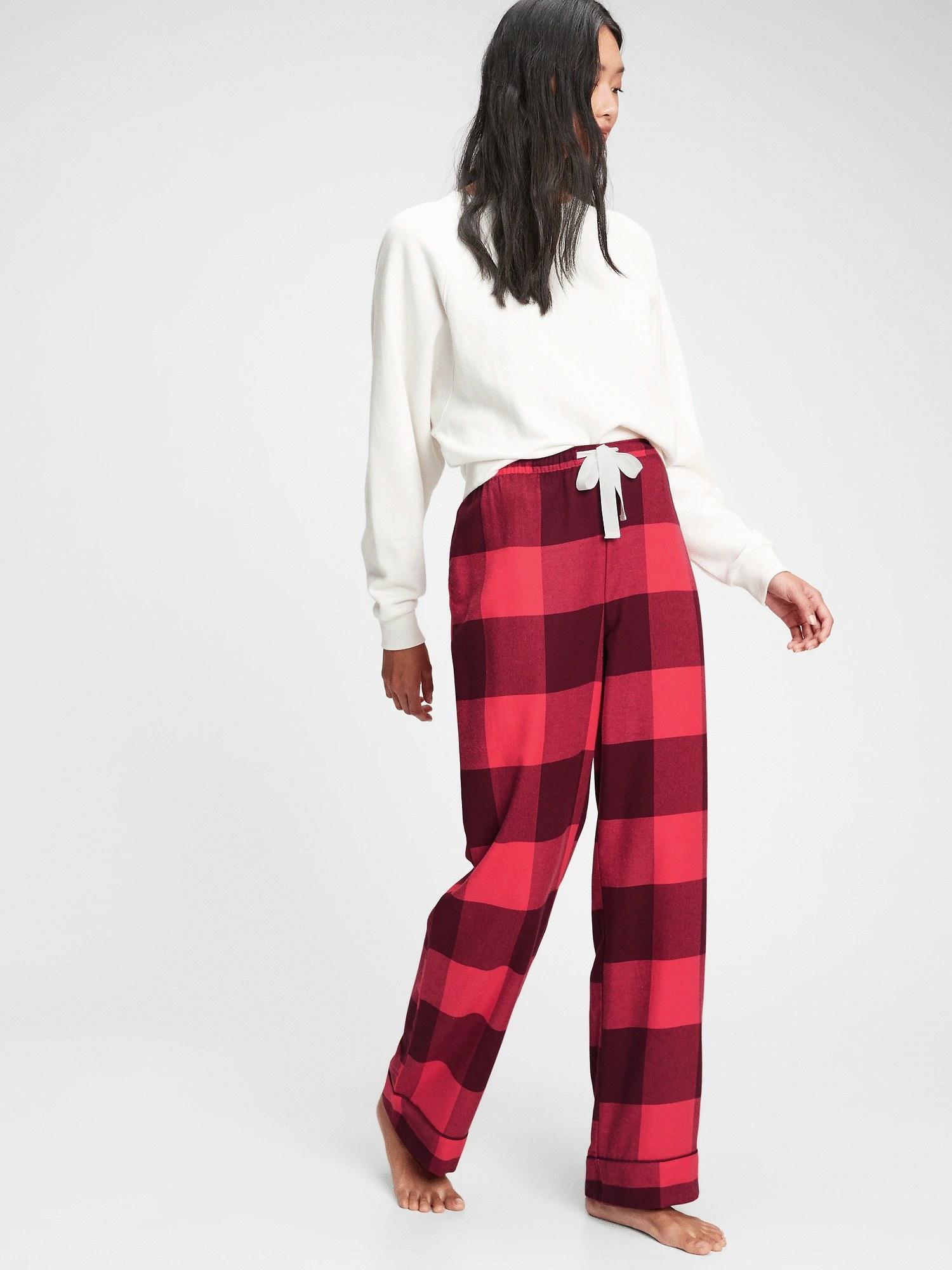Model wearing flannel pajama pants