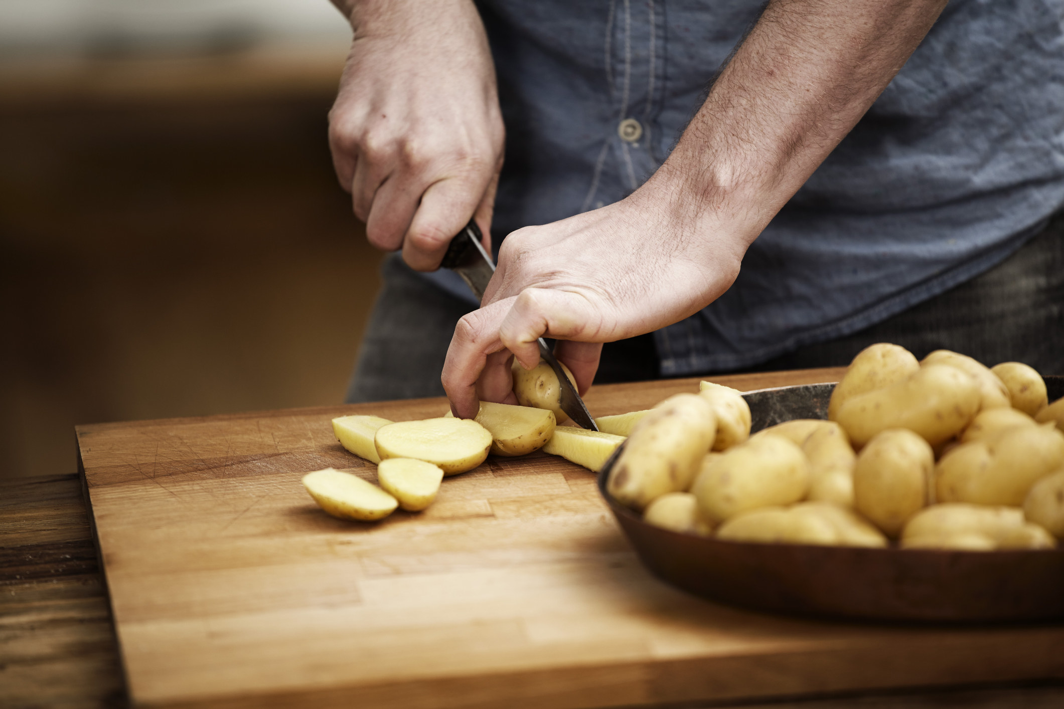 hand cutting potatoes