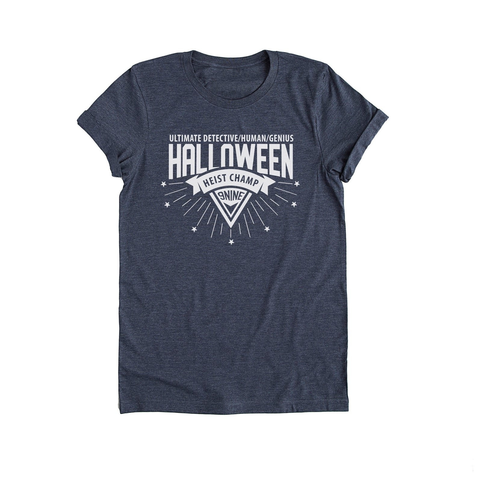 """A crewneck tee that says """"ultimate detective/human/genius"""" in small text and """"halloween heist champ"""" """"99"""" in large text"""