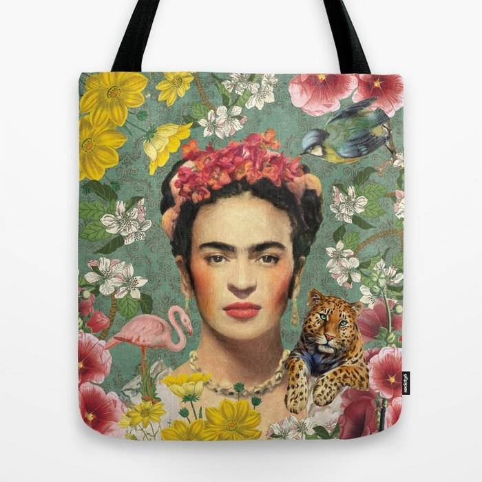 A flower-print tote featuring a color photo of Frida on it