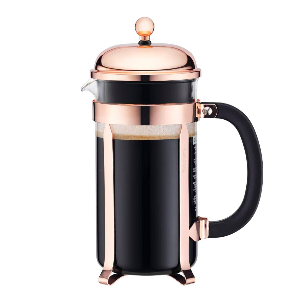 copper french press with coffee