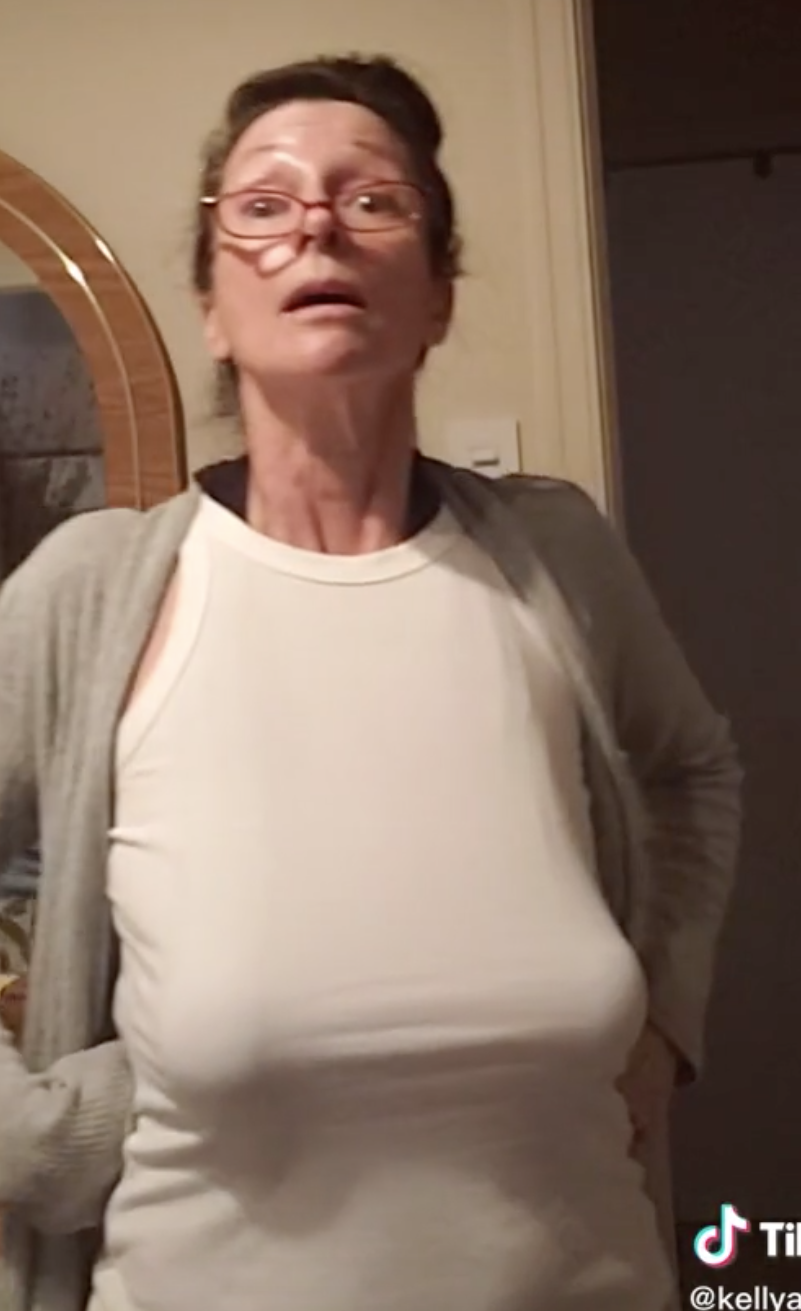 Photo of mom accentuating her boobs.