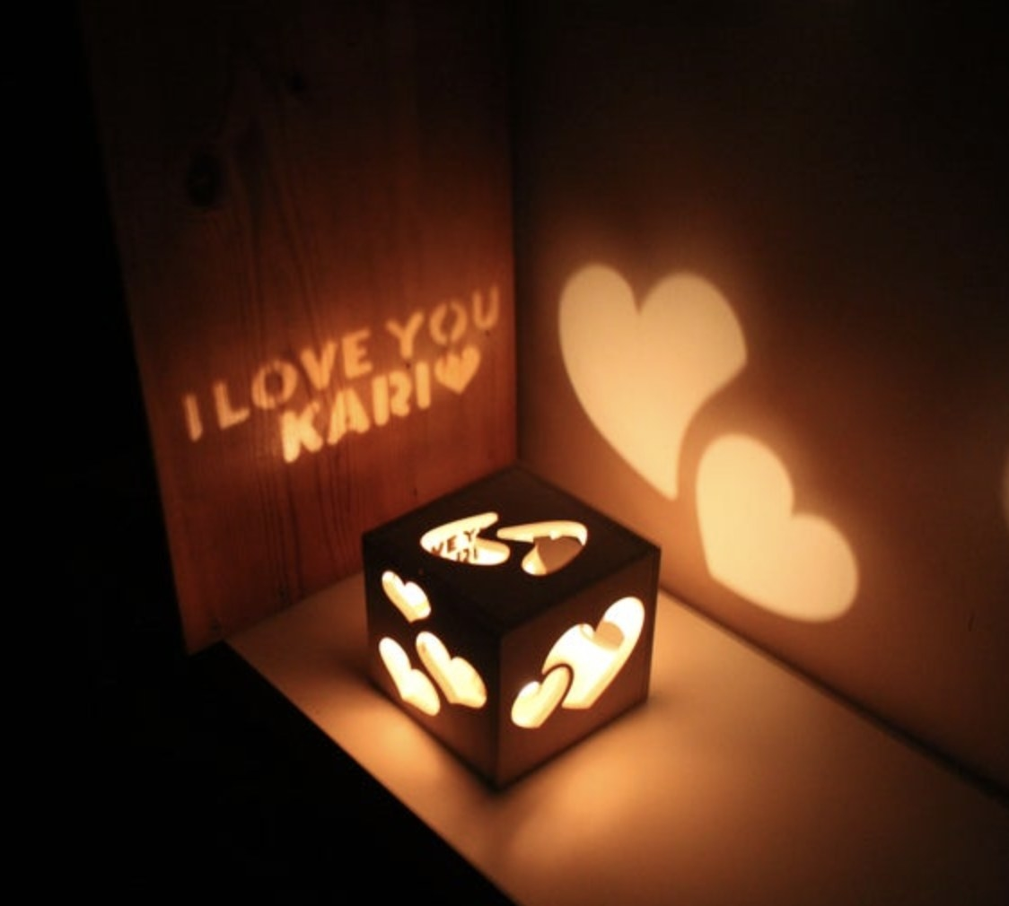 The etched box with the words I love your Kari projected onto a wall