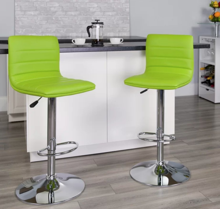 Lime green chairs with silver metal base