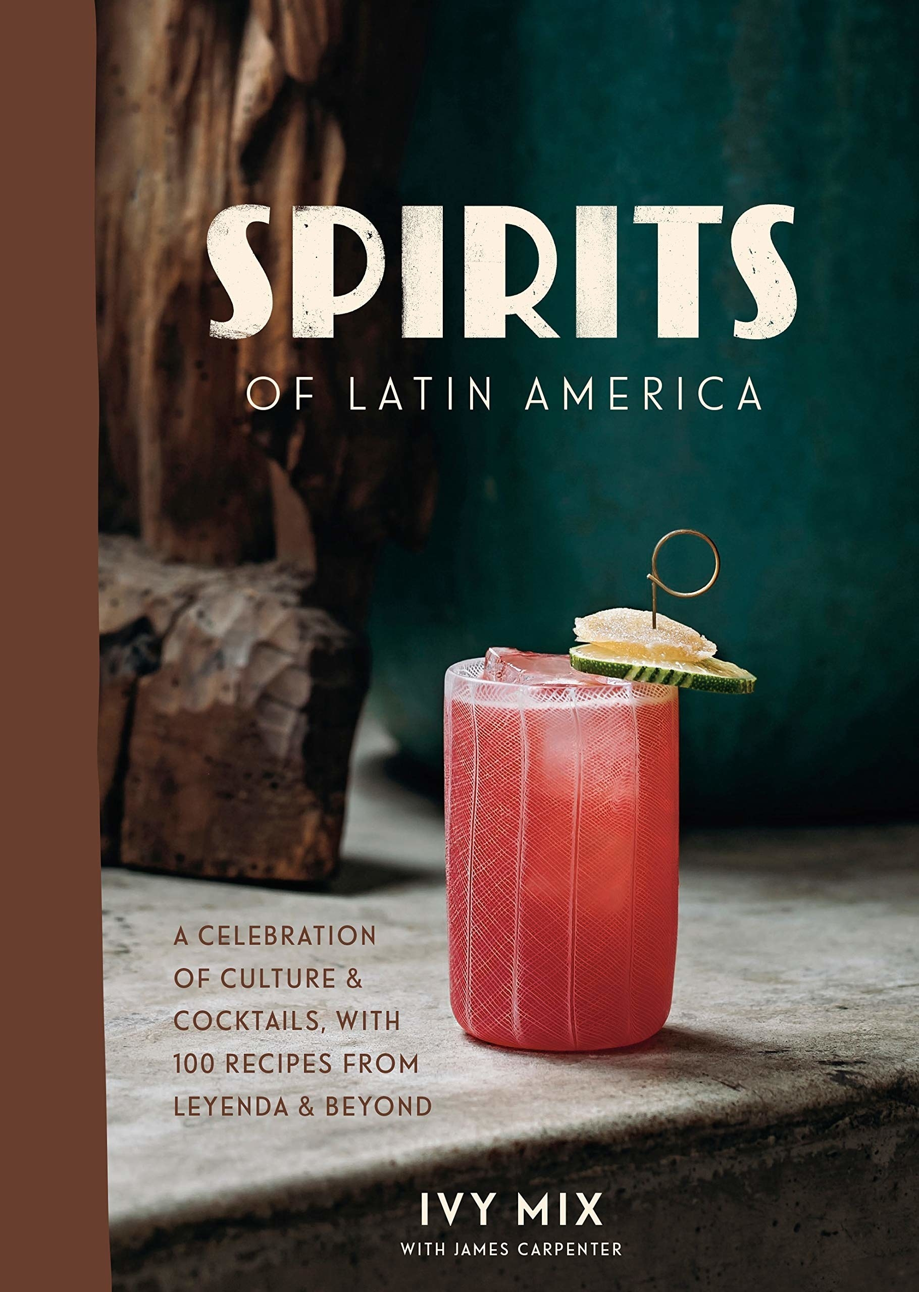 The book cover featuring a pink tropical drink on a wooden table
