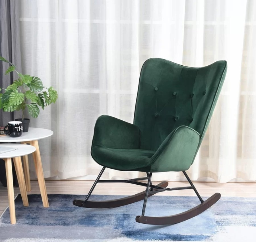 Green velvet wing-backed rocking chair