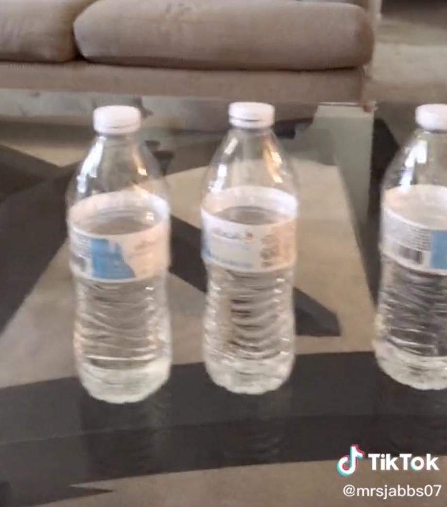 Half empty water bottles.