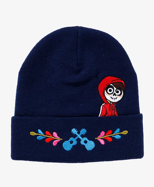 A navy beanie with Miguel on it