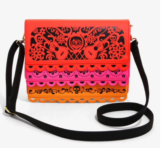 A papel picado purse with Miguel on the flap