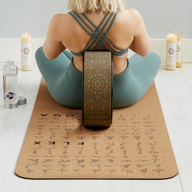 A person sitting on the yoga mat