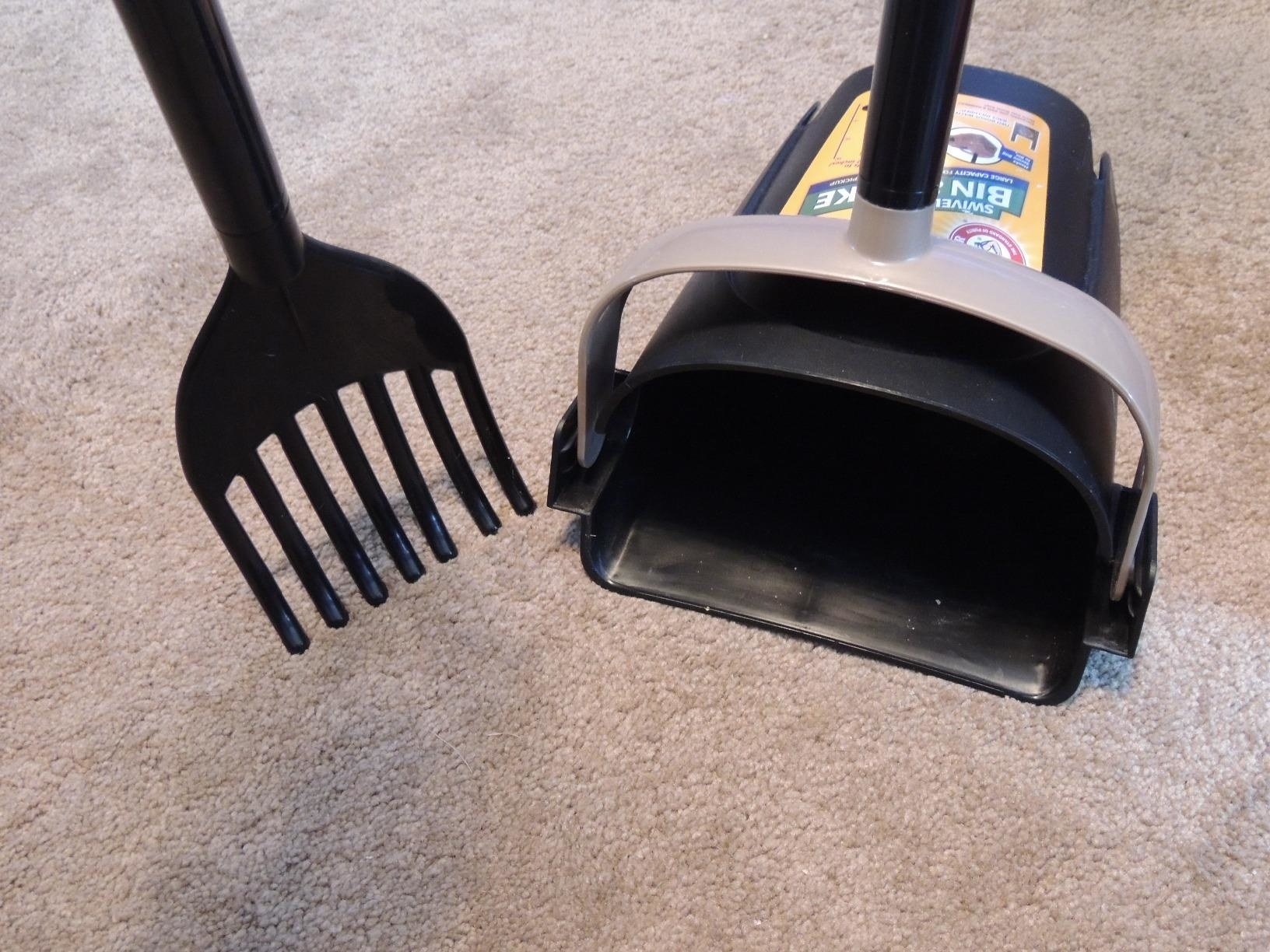 The rake and the bin, both of which are mounted on long handles