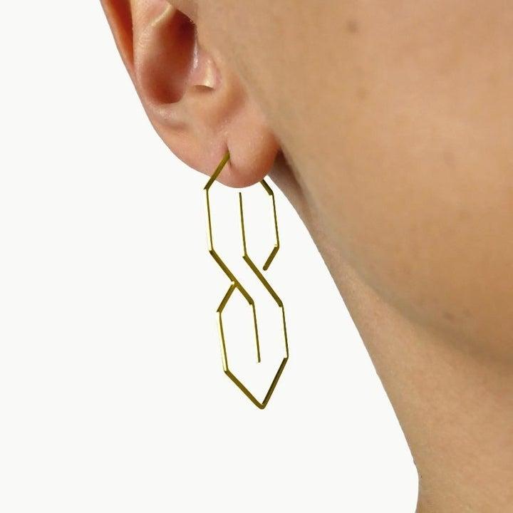 Model wearing the gold earrings