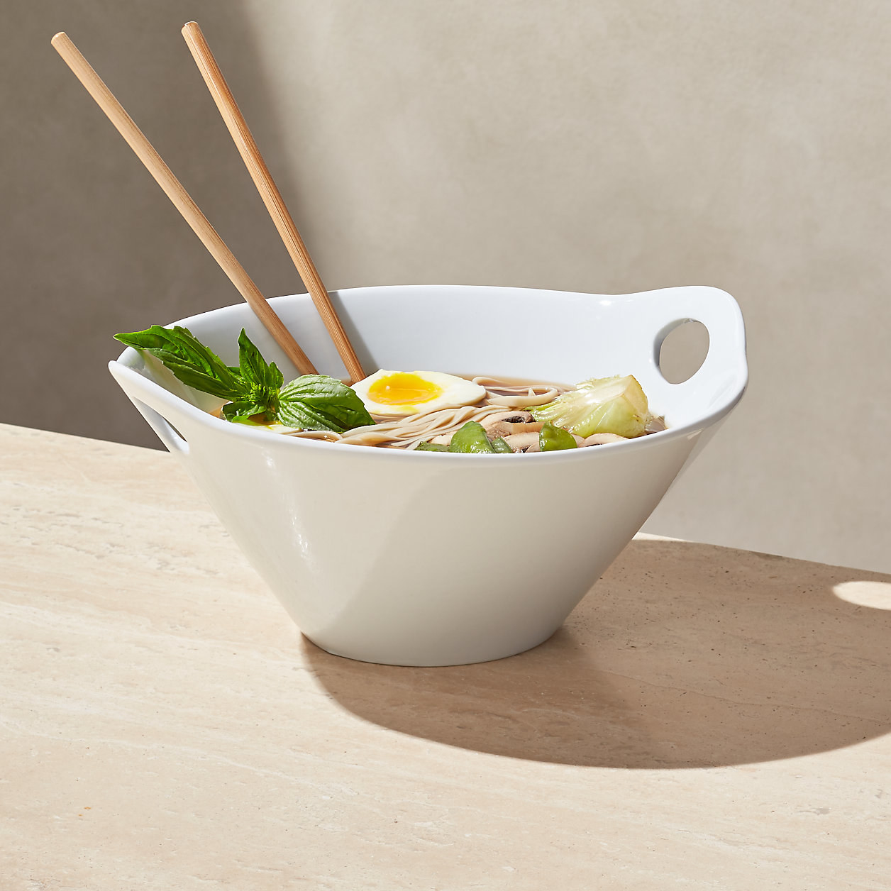 The white ramen bowl with holes for the chopsticks