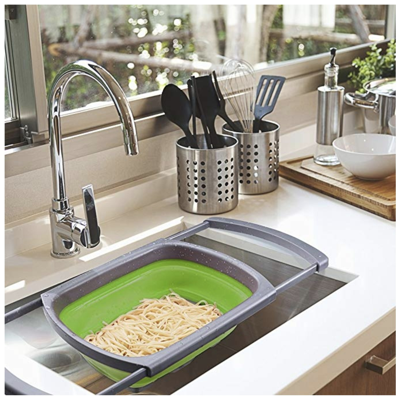over-the-sink colander with noodles in it
