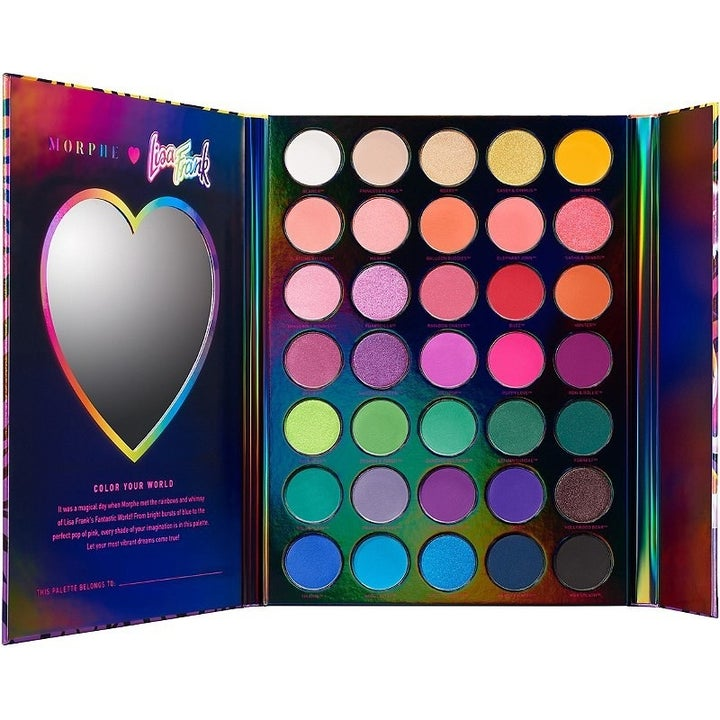 the palette with the cover opened up to reveal a heart-shaped mirror inside of it and the rainbow eyeshadows