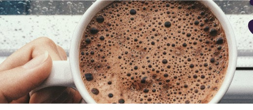 A mug of frothy hot chocolate.