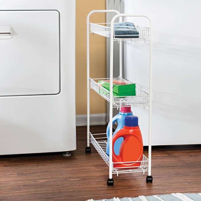 White cart with laundry supplies