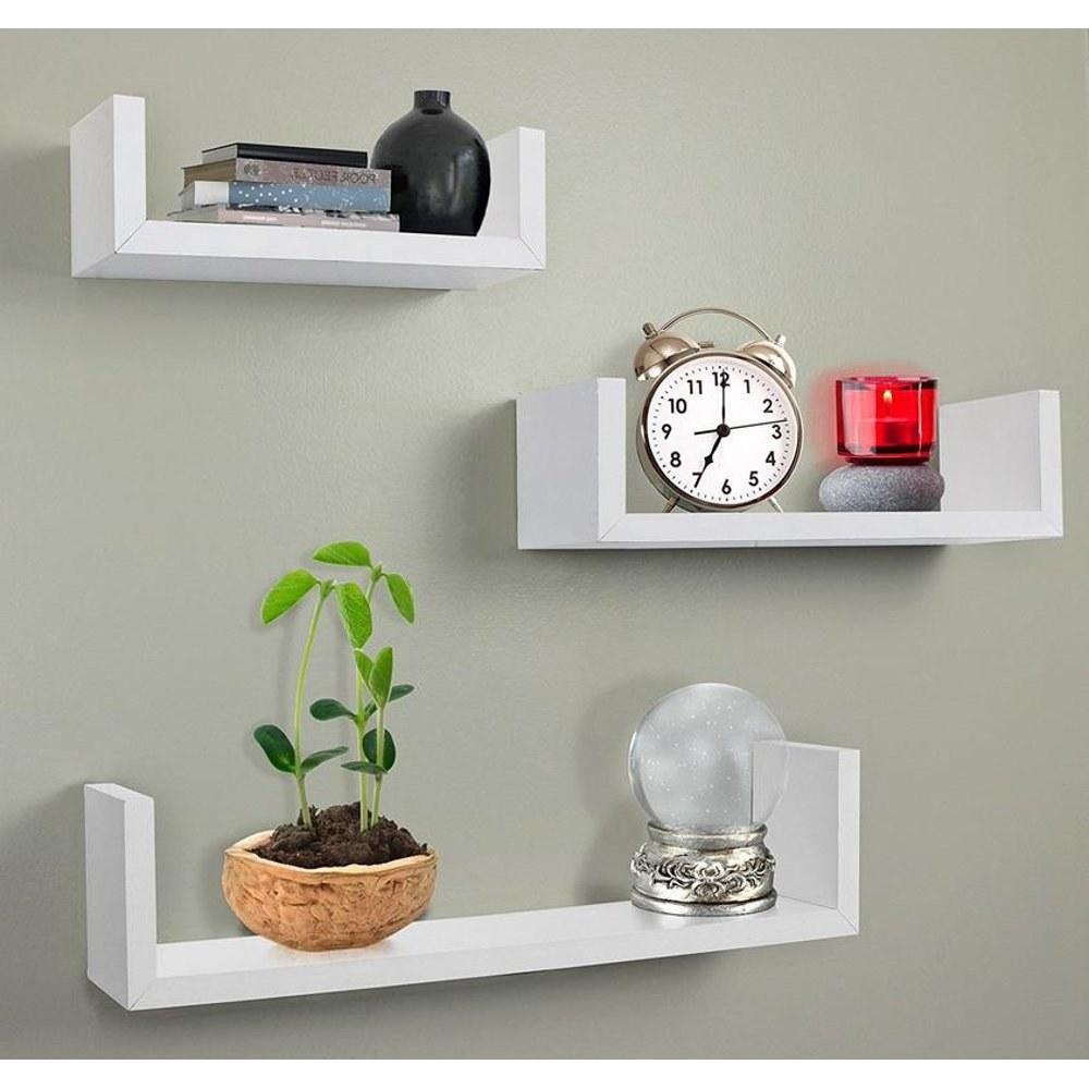 Three white floating shelves