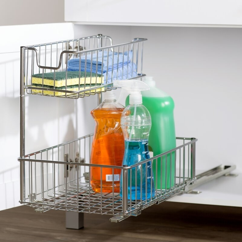 Pull out drawer with cleaning products.