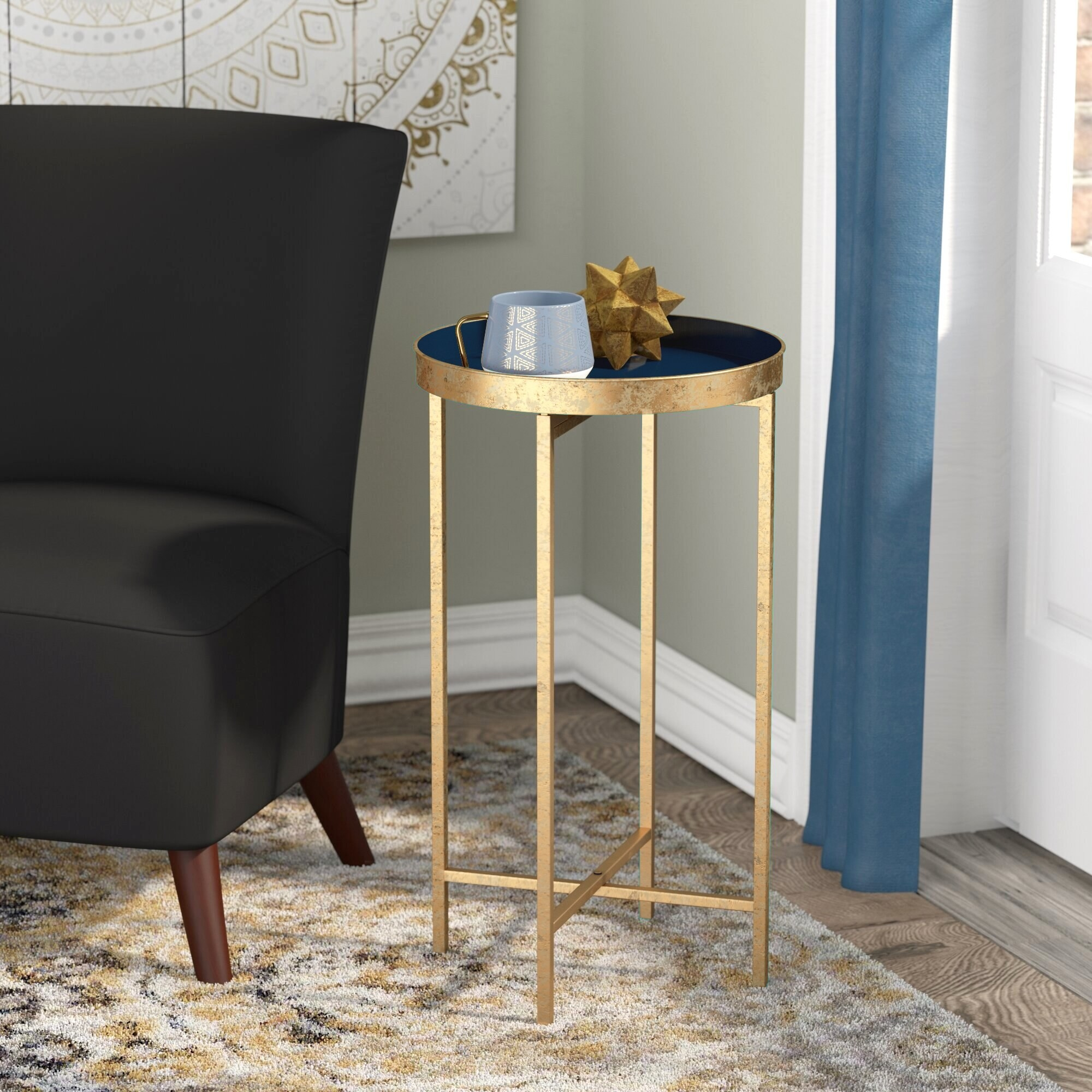 End table staged next to chair.