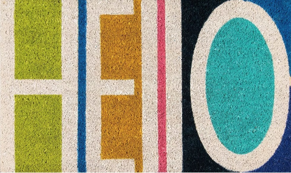 "Multicolored doormat that says ""hello"""