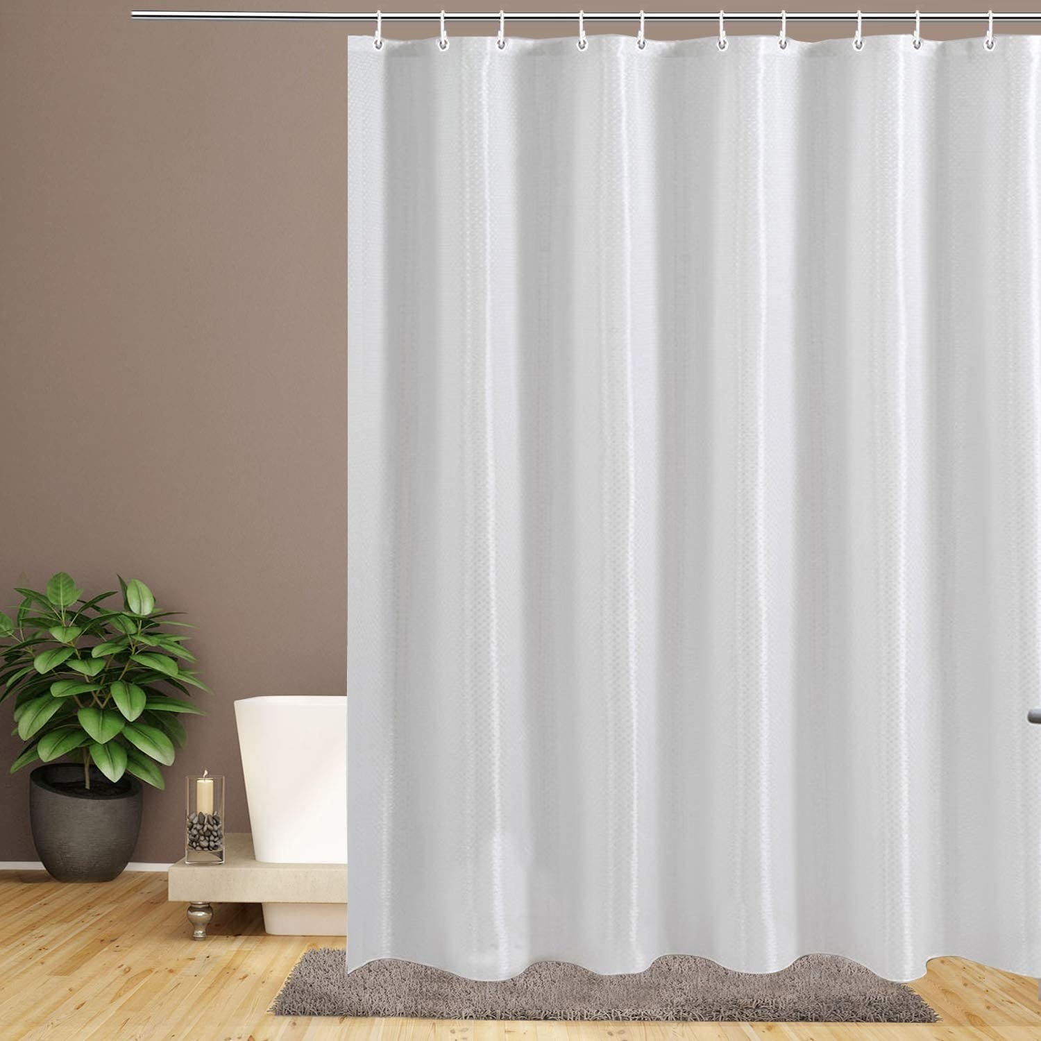 A plain shower curtain hanging in a bathroom