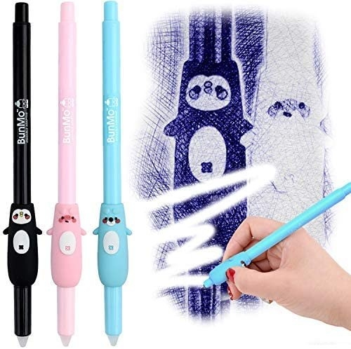 The three pens with grips shaped like a penguin, pig, and bear next to a hand using one to erase blue ink
