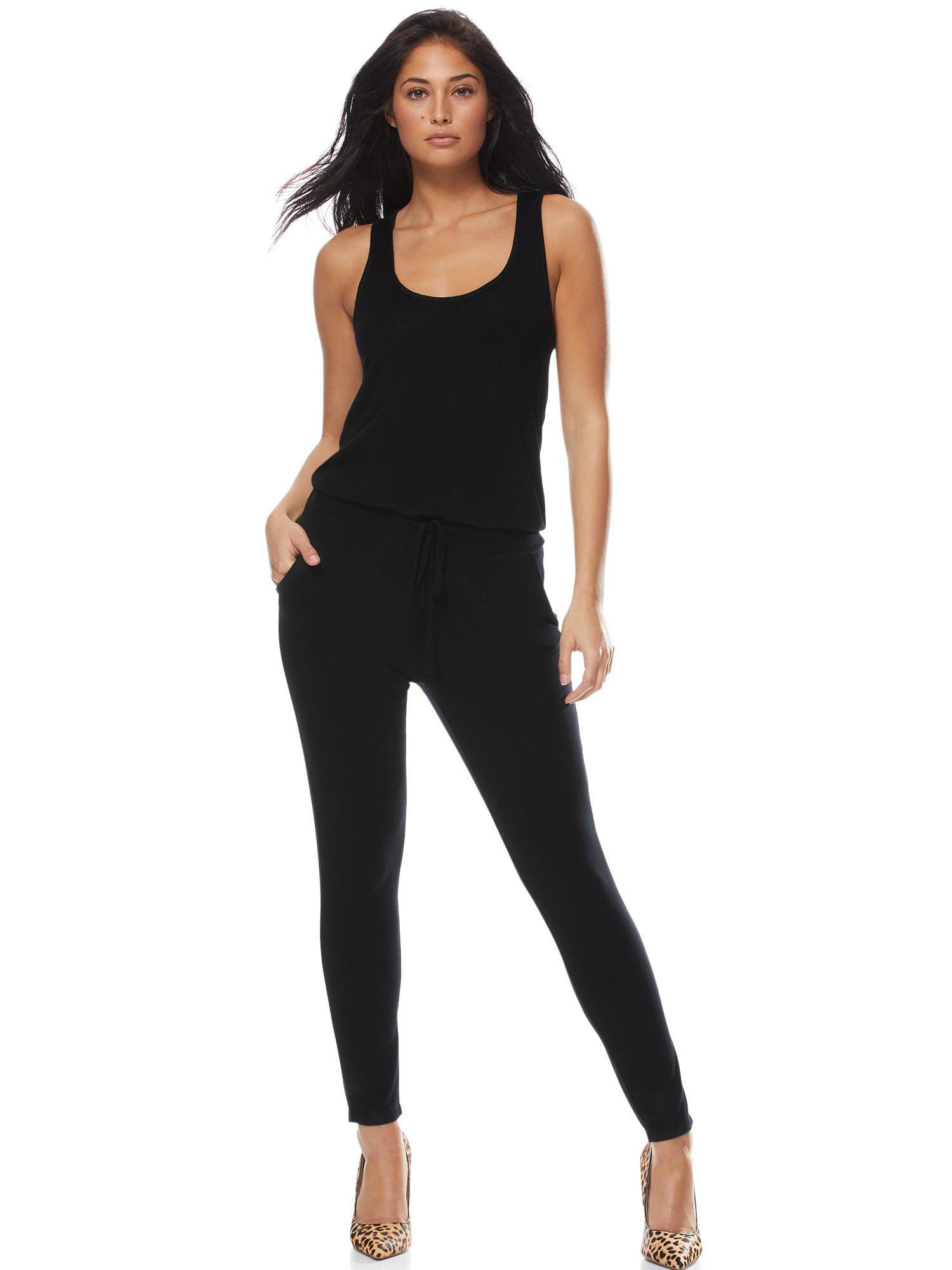 Model wearing a black jumpsuit