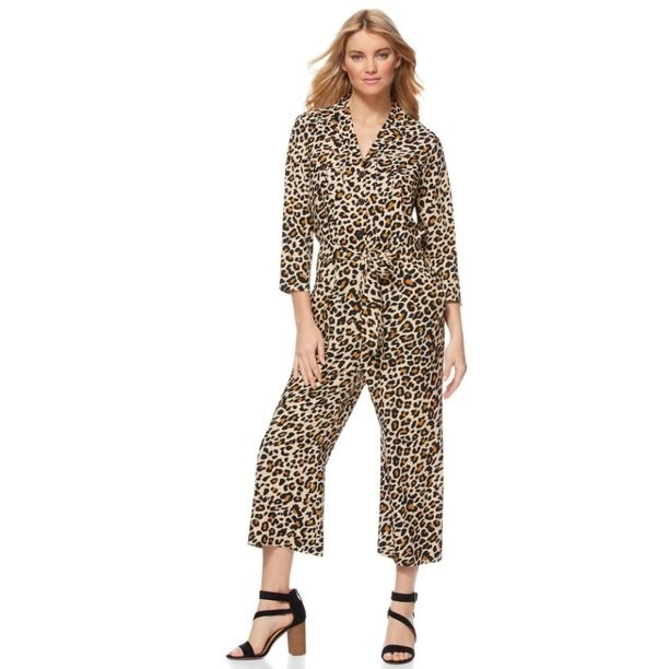 A model wearing an animal print jumpsuit