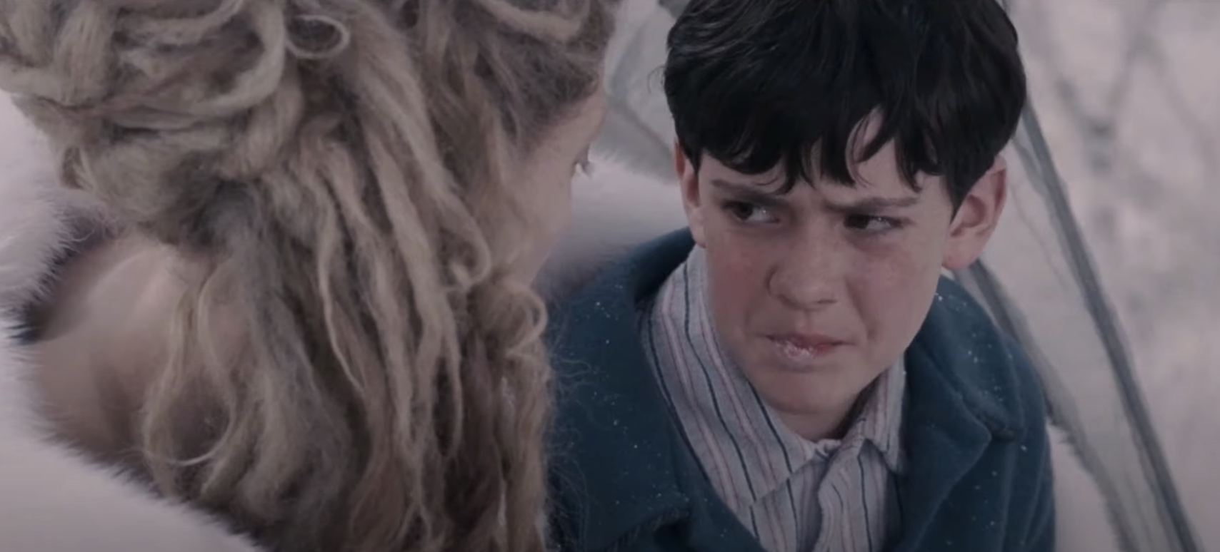 Edmund talking to the White Witch in the carriage