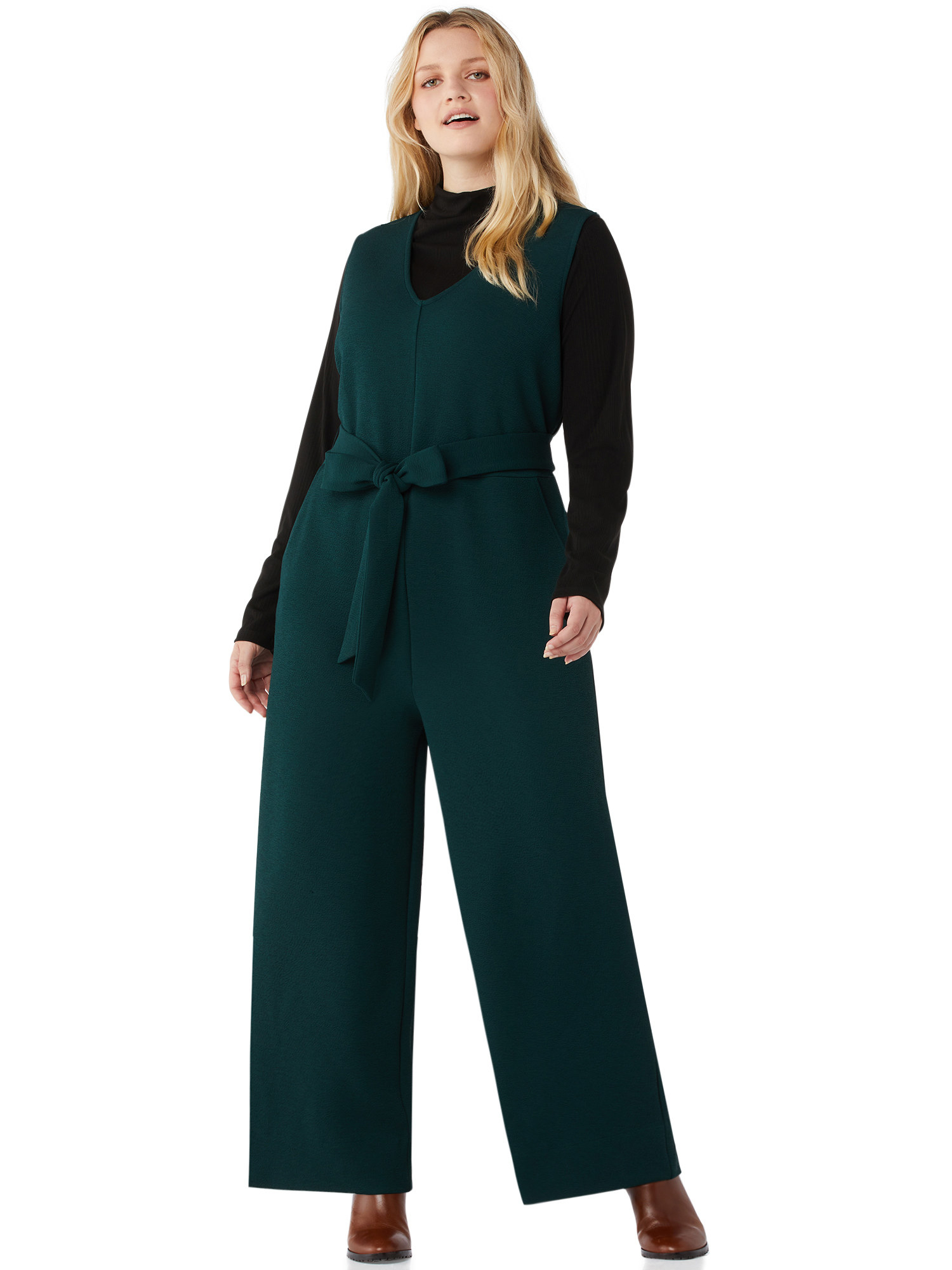Model wearing a green jumpsuit