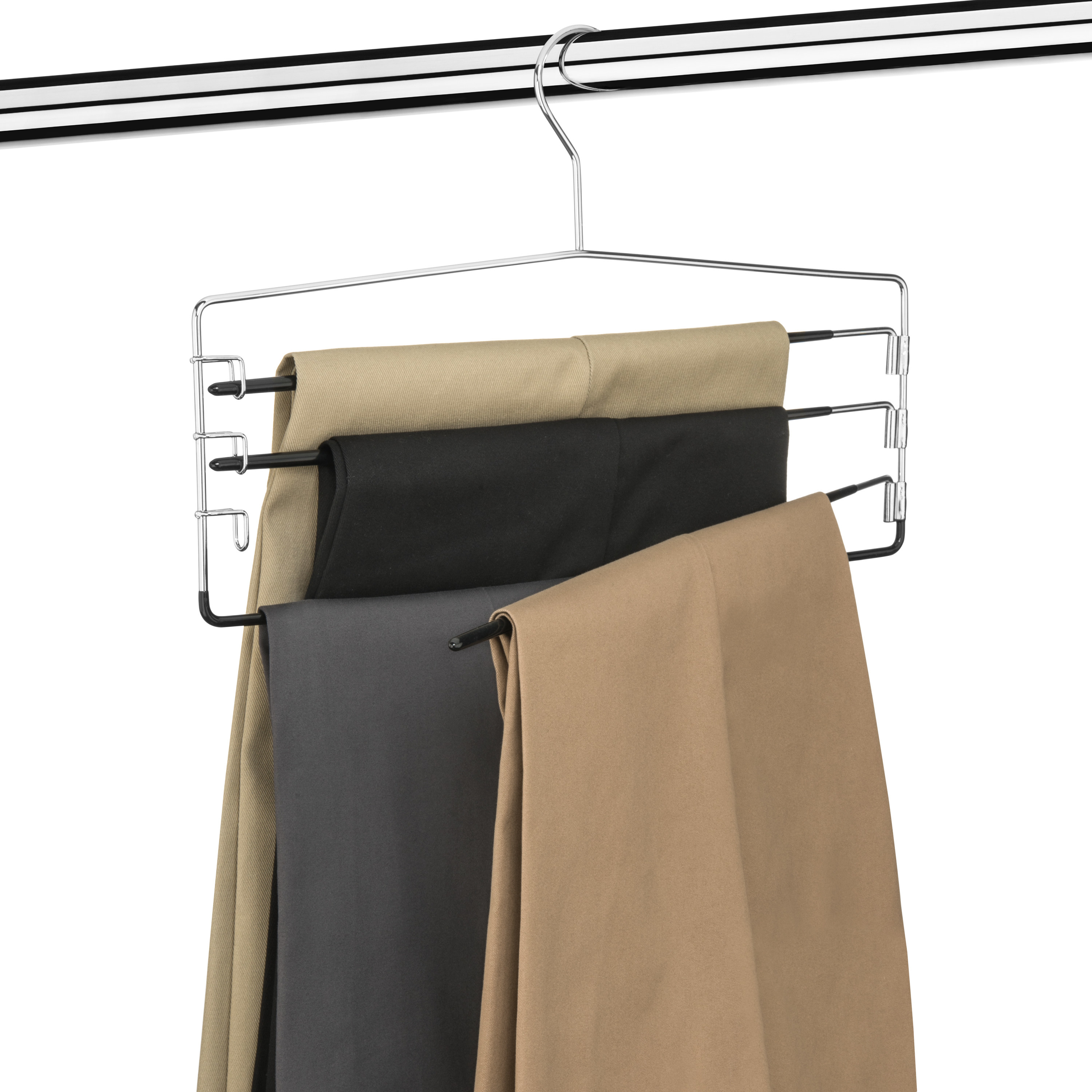 Pants hanging from tiered hanger in closet
