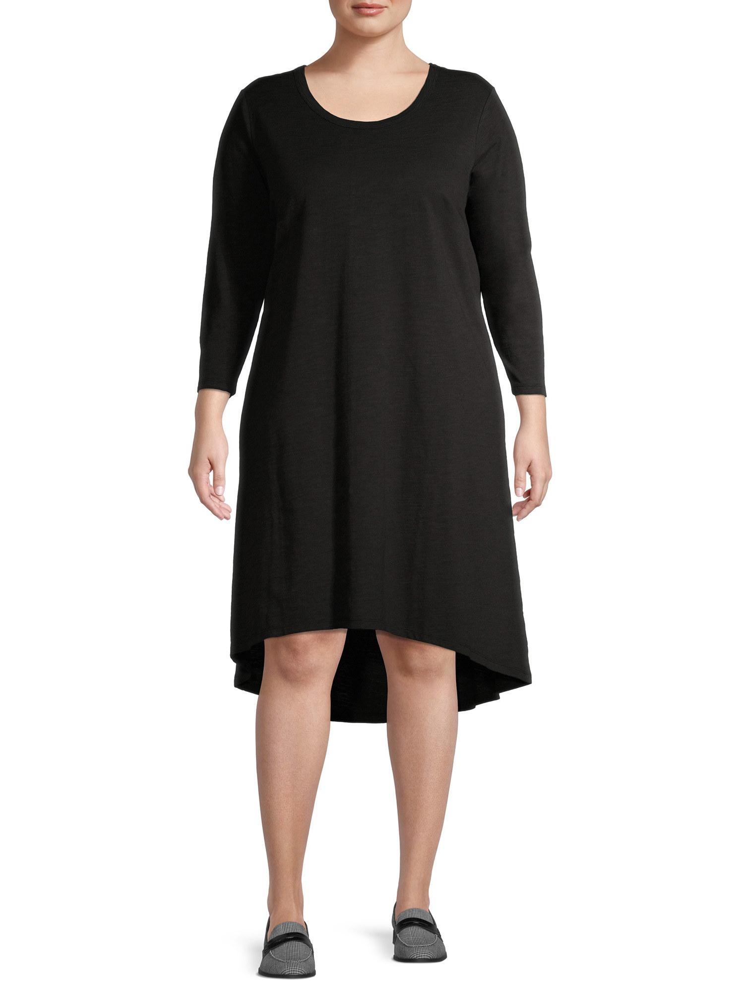 model wearing a black high-low dress