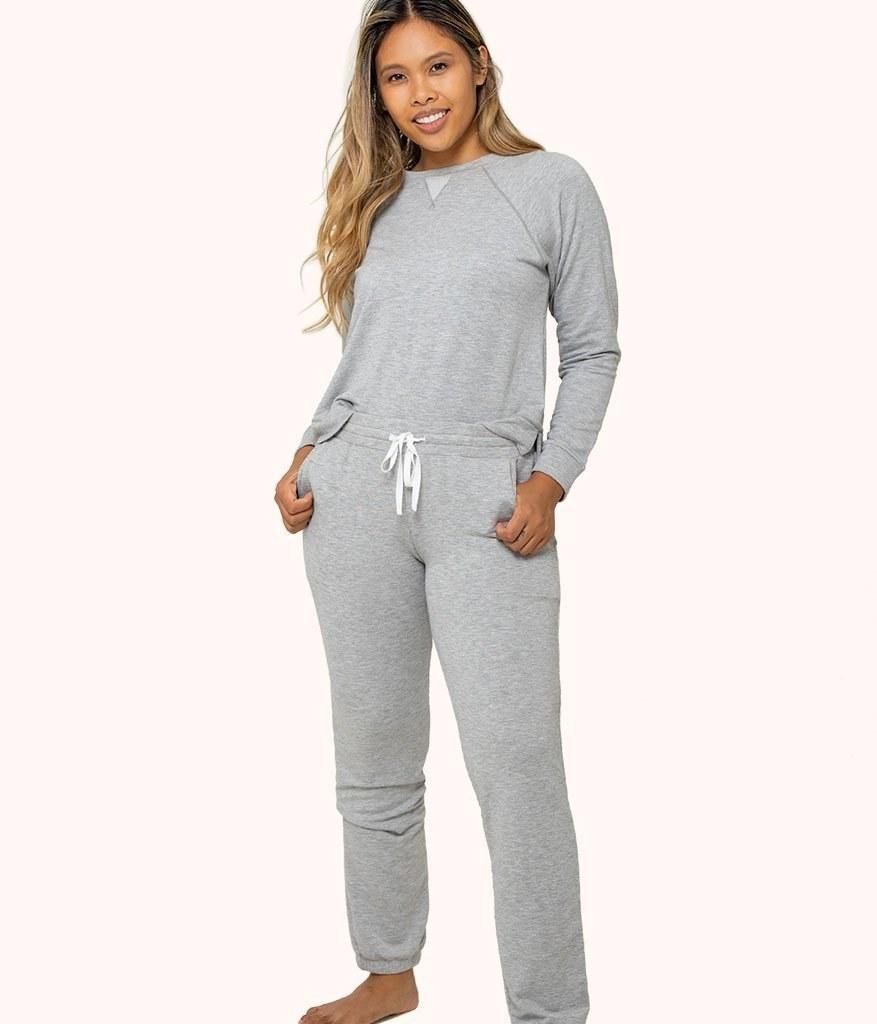 Model wearing gray lounge pants