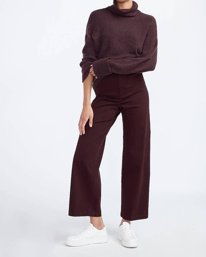 Model wearing flared pants