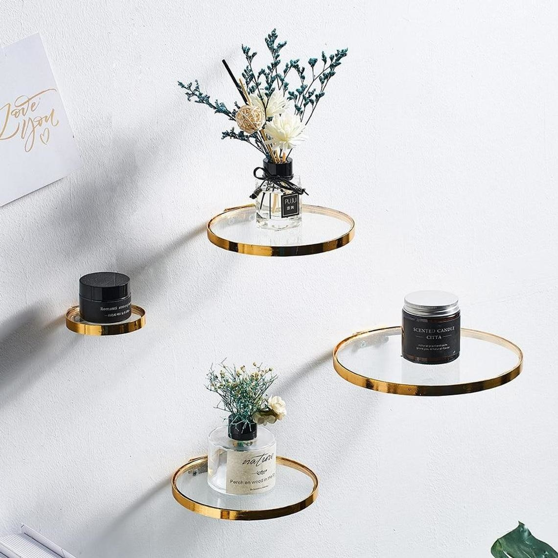 glass round shelves with gold outer rim