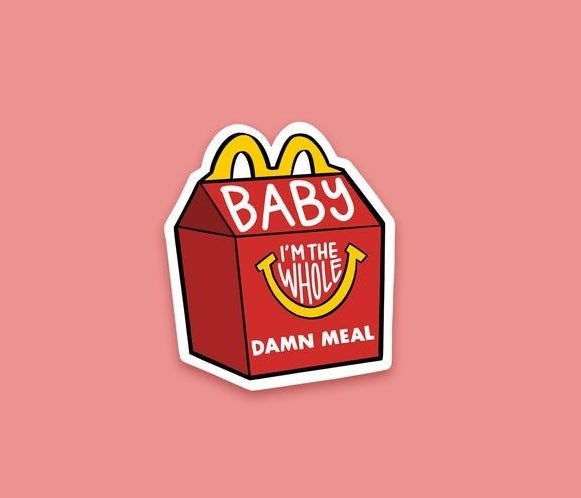 "The sticker shaped like a Happy Meal box with the words ""Baby I'm the whole damn meal"""