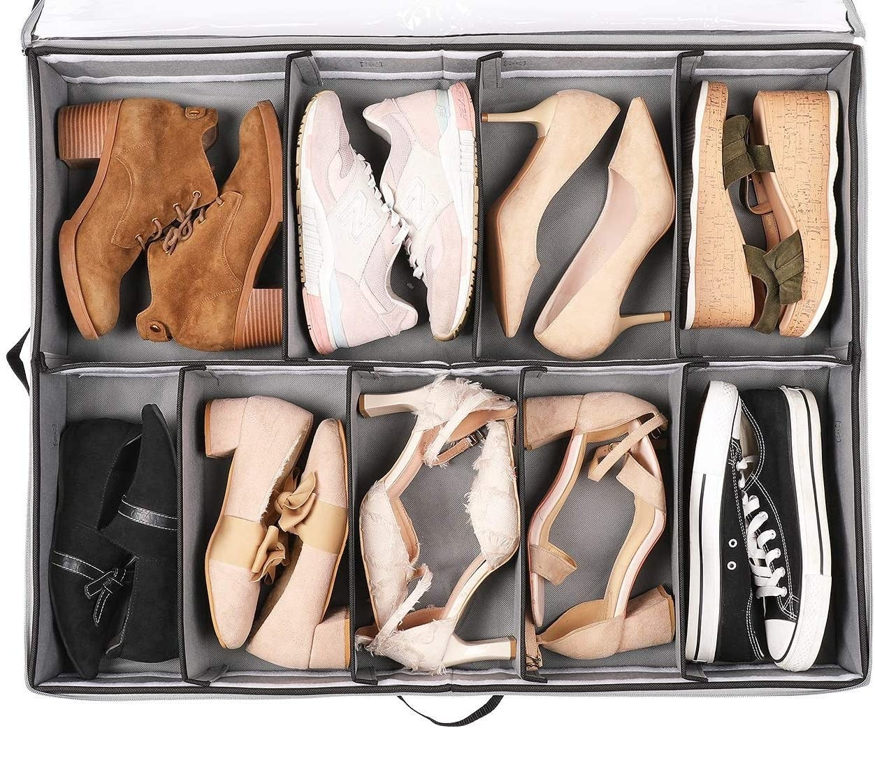 A large fabric bin with nine pairs of shoes organized inside
