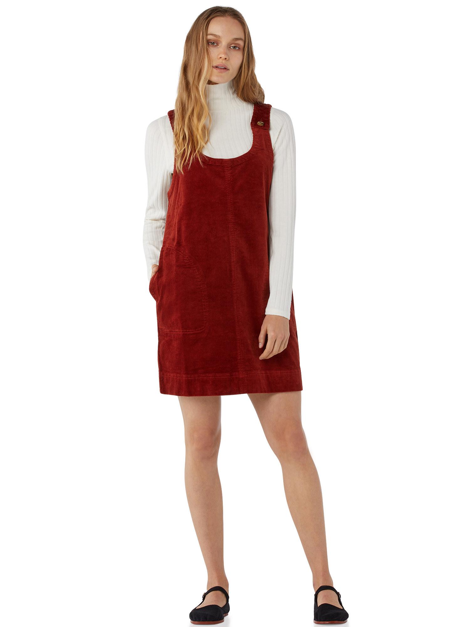 Model wearing rust-colored jumper dress