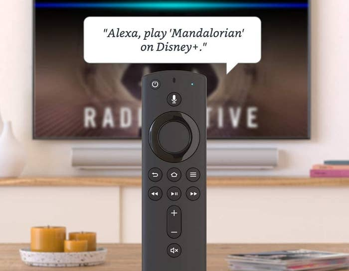 """the fire stick's remote with the caption """"alexa, play mandelorian on Disney plus"""""""