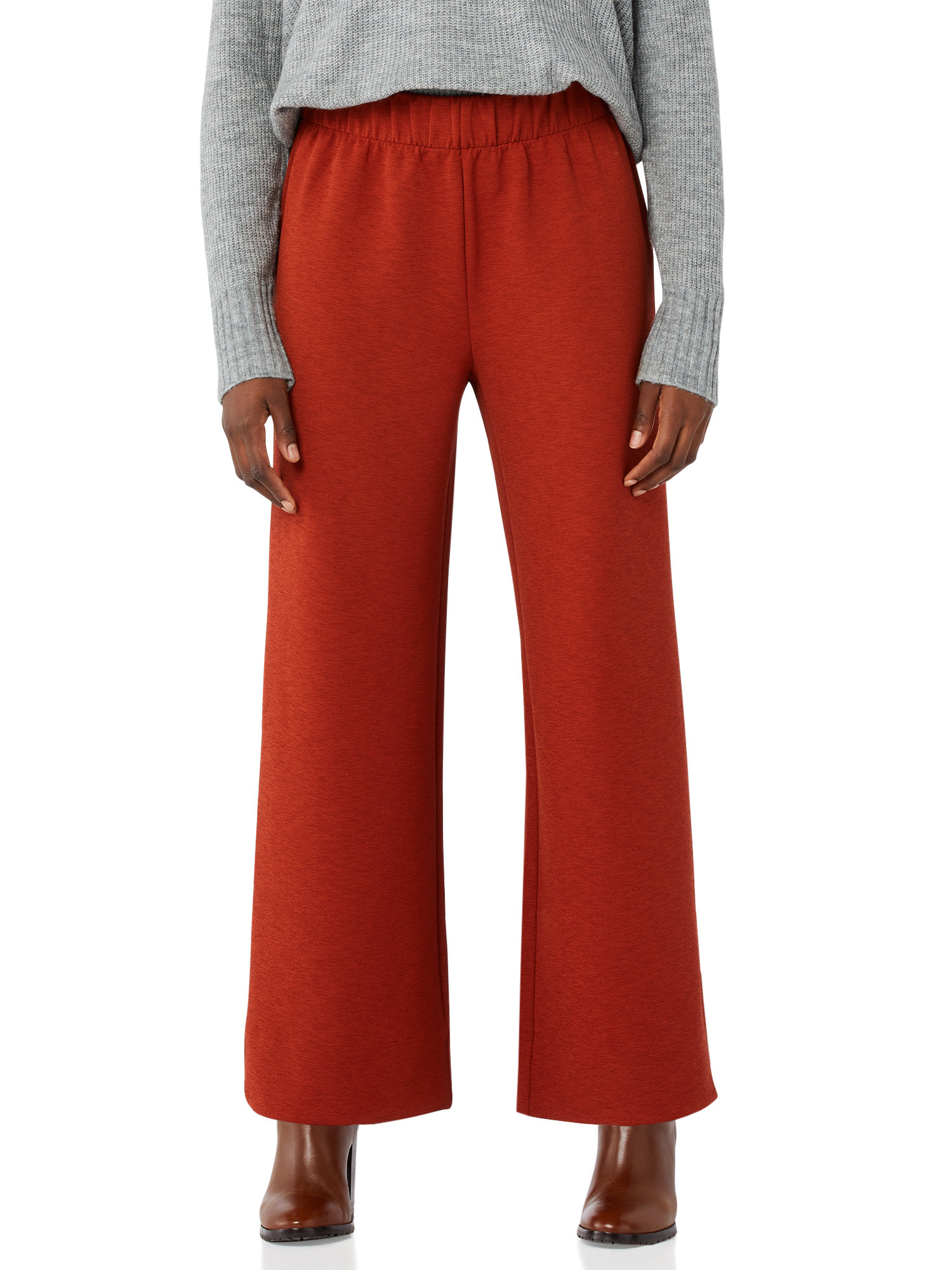 Model wearing orange pants