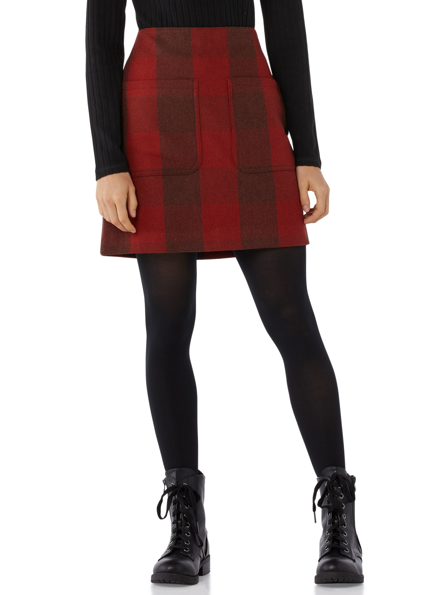 Model wearing a red plaid skirt